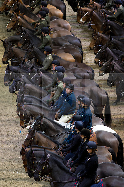 © Licensed to London News Pictures. 06/12/2012. London, UK. Soldiers and horses of the Household Cavalry and the King's Troop Royal Horse Artillery line up as part of the press preview of the 2012 Military Tournament. Held on the 8th and 9th of December at Earl's Court, the show features over 600 participants from all three services. Photo credit: Matt Cetti-Roberts/LNP