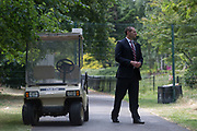 An American Secret Service agent guards a temporary perimeter fence encircling Winfield House, the official residence of the US Ambassador during the visit to the UK of US President, Donald Trump, on 12th July 2018, in Regents Park, London, England.