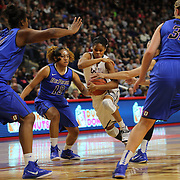 Moriah Jefferson, UConn, drives past the DePaul defenders during the UConn Vs DePaul, NCAA Women's College basketball game at Webster Bank Arena, Bridgeport, Connecticut, USA. 19th December 2014