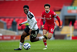 LIVERPOOL, ENGLAND - Sunday, March 7, 2021: Fulham's Ola Aina (L) and Liverpool's Trent Alexander-Arnold during the FA Premier League match between Liverpool FC and Fulham FC at Anfield. Fulham won 1-0 extending Liverpool's run to six consecutive home defeats. (Pic by David Rawcliffe/Propaganda)