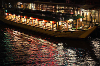 """Yakatabune boats on the Sumida River - """"yakatabune asobi"""" - meaning something like """"roofed-boat fun"""" is a pleasure synonymous with summer in Tokyo. The boats were first used exclusively by aristocrats and samurai from the eighth century but nowadays anyone with the yen can enjoy. They have always been closely associated with Tokyo Bay and the Sumida River as they are today."""