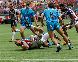 March 10, 2018 - Vancouver, British Columbia, U.S. - VANCOUVER, BC - MARCH 10: Ben Pinkelman (#2) of USA tackled roughly during Game # 8- Usa vs Uruguay Pool A match at the Canada Sevens held March 10-11, 2018 in BC Place Stadium in Vancouver, BC. (Photo by Allan Hamilton/Icon Sportswire) (Credit Image: © Allan Hamilton/Icon SMI via ZUMA Press)