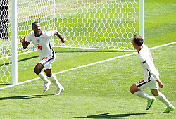 England's Raheem Sterling (left) celebrates scoring their side's first goal of the game with team-mate Mason Mount during the UEFA Euro 2020 Group D match at Wembley Stadium, London. Picture date: Sunday June 13, 2021.