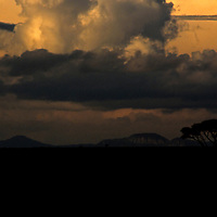 Africa, Tanzania, Serengeti. Clouds gather as the sun sets over the Serengeti.