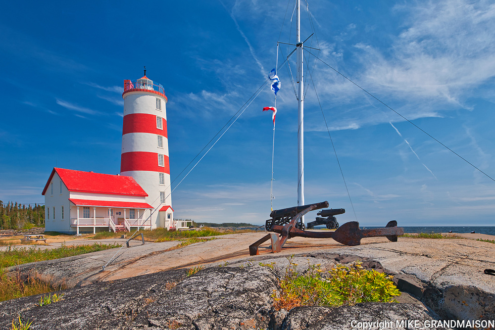 Ligthouse on the shore of the St. Lawrence River. Côte-Nord<br />Pointe-des-Monts<br />Quebec<br />Canada