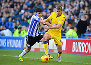 Sheffield Wednesday Forward Fernando Forestieri and Leeds United Defender Scott Wootton challenge for the ba;; during the Sky Bet Championship match between Sheffield Wednesday and Leeds United at Hillsborough, Sheffield, England on 16 January 2016. Photo by Adam Rivers.