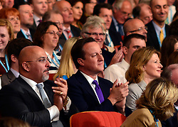 © Licensed to London News Pictures. 08/10/2012. Birmingham, UK The Prime Minister, David Cameron, sits with delegates as Chancellor of the Exchequer George Osborne makes his keynote conference speech at The Conservative Party Conference at the ICC today 8th October 2012. Photo credit : Stephen Simpson/LNP