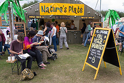 People eating at an cafe at the WOMAD (World of Music; Arts and Dance) Festival in reading; 2005,