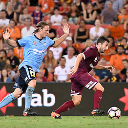 BRISBANE, AUSTRALIA - FEBRUARY 3: Tommy Oar of the Roar dribbles the ball under pressure from Rhyan Grant of Sydney during the round 18 Hyundai A-League match between the Brisbane Roar and Sydney FC at Suncorp Stadium on February 3, 2017 in Brisbane, Australia. (Photo by Patrick Kearney/Brisbane Roar)