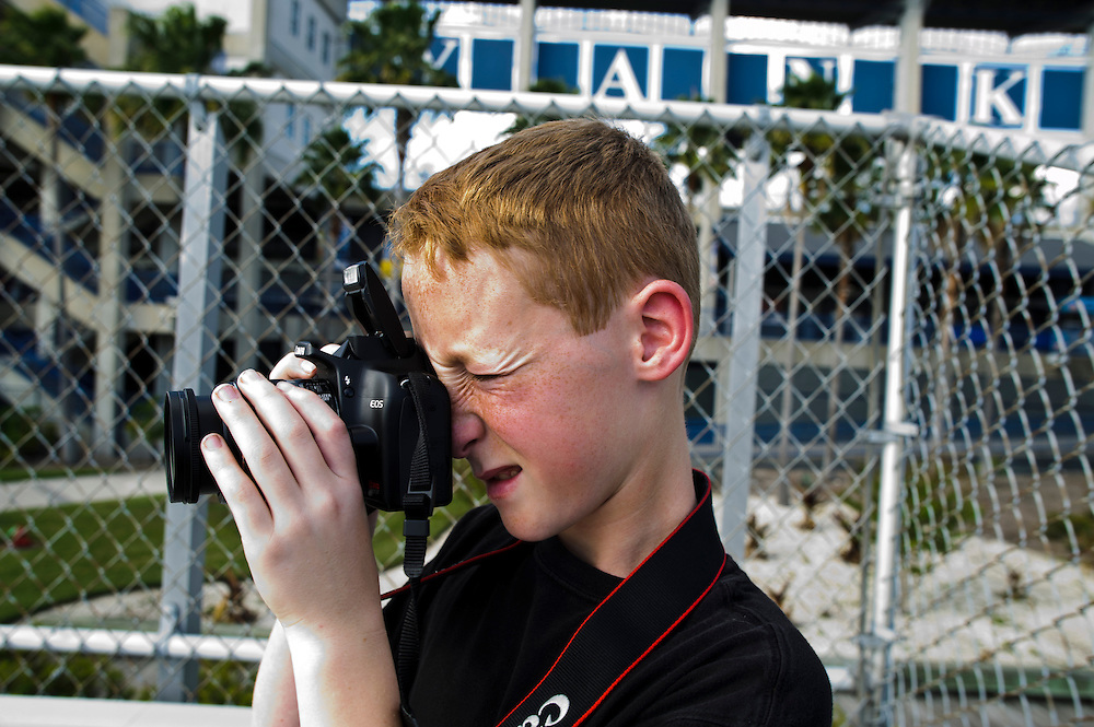 """(photo by Matt Roth).Thursday, March 8, 2012..George M. Steinbrenner Field, Spring Training site for the New York Yankees in Tampa, Florida, Thursday, March 8, 2012..Allen Born and his 10-year-old son Caleb Born, from Sacramento, California,  take pictures of the Yankees Spring Training Stadium in Tampa, Florida Thursday, March 8, 2012 for a school project. Rather than miss school, Caleb is conducting a school-sanctioned independent study. Caleb is a Giants fan saw them during Spring Training last year in the Cactus League in Arizona, but Allen is a """"die hard"""" Detroit Tigers fan. Neither are big Yankees fans, but Caleb's teacher is."""