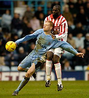 Photo. Glyn Thomas. 22/02/2005.<br /> Coventry City v Stoke City. Coca Cola Championship.<br /> Stoke's Michael Ricketts (R) clatters into Coventry's Andrew Whing.