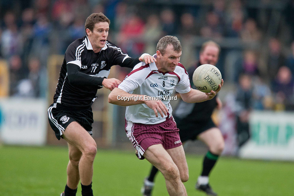 Brian Considine and Frank O'Dea  in action  during the Doonbeg V Liscannor ,Clare Senior Football County final in Ennis on Sunday. Photograph by Eamon Ward