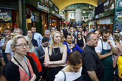June 14, 2017 - London, London, UK - London, UK. Traders and shoppers wait for one minutes silence to be observed in Borough Market, London as it reopens on 14 June 2017, following a terror attack that killed 8 people over a week ago. (Credit Image: © Tolga Akmen/London News Pictures via ZUMA Wire)