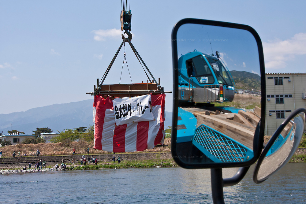 A crane lifts a box containing fifteen thousand rubber ducks that will be emptied in to the Sakawa River during the Ashigara River festival, Kintaro duck-race in Matsuda, Kanagawa, Japan April 25th 2010