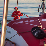 Leg 4, Melbourne to Hong Kong, day 08 on board MAPFRE, Pablo Arrarte stearing in a sunset without wind. Photo by Ugo Fonolla/Volvo Ocean Race. 09 January, 2018.