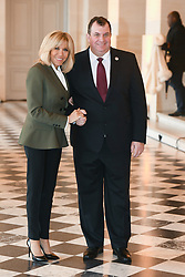 French President's wife Brigitte Macron welcomes Croatian president's husband Jakov Kitarovic as they take part in a spousal event at the Chateau de Versailles in Versailles, near Paris, on November 11, 2018 as part of commemorations marking the 100th anniversary of the 11 November 1918 armistice, ending World War I. Photo By Laurent Zabulon/ABACAPRESS.COM