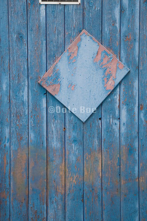wooden door with weathered blue paint