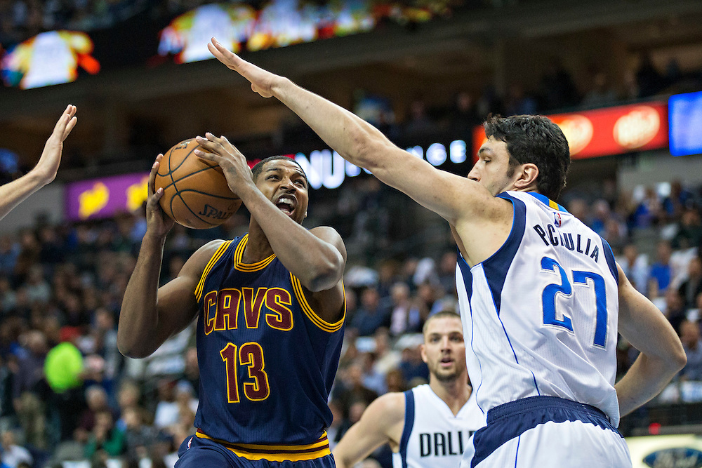 DALLAS, TX - JANUARY 12:  Tristan Thompson #13 of the Cleveland Cavaliers goes up for a shot against Zaza Pachulia #27 of the Dallas Mavericks at American Airlines Center on January 12, 2016 in Dallas, Texas.  NOTE TO USER: User expressly acknowledges and agrees that, by downloading and or using this photograph, User is consenting to the terms and conditions of the Getty Images License Agreement.  The Cavaliers defeated the Mavericks 110-107.  (Photo by Wesley Hitt/Getty Images) *** Local Caption *** Tristan Thompson; Zaza Pachulia