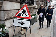 Men at work sign with devils horns in the City of London on 28th January 2020 in London, England, United Kingdom. The City of London is a historic financial district, home to both the great banking buildings. Modern corporate skyscrapers tower above the vestiges of medieval alleyways below.