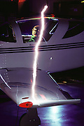 High voltage long arc discharge to a Glassair (fiberglass) kit airplane.  The airplane's fiberglass has been impregnated with an aluminum screen to prevent damage from lightning. Testing is to prove this including tests with dummy to make sure there is no flash over to the pilot. Lightning Technologies, Inc., Pittsfield, Massachusetts. (1992)