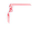 Pink streamer ribbon on white background