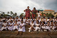 A group of fourth and fifth grade girls and their teachers, all from the city of Kandy, enjoy a school field trip, which includes eating ice cream at sunset in Galle Face Green in Colombo, Sri Lanka. (March 30, 2017)