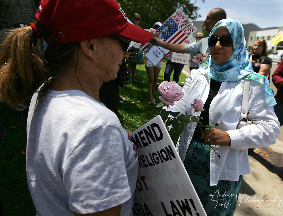 /Andrew Foulk/ For The Californian/ .Gabbi Ayoub, tries to hand roses to protesters who are opposed to the Temecula  Islamic Center's building of a new mosque in Temecula.