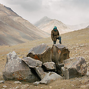 """Shepherd. Camp at a Wakhi high pasture names """"Warm"""", below Garumdee Pass. Guiding and photographing Paul Salopek while trekking with 2 donkeys across the """"Roof of the World"""", through the Afghan Pamir and Hindukush mountains, into Pakistan and the Karakoram mountains of the Greater Western Himalaya."""