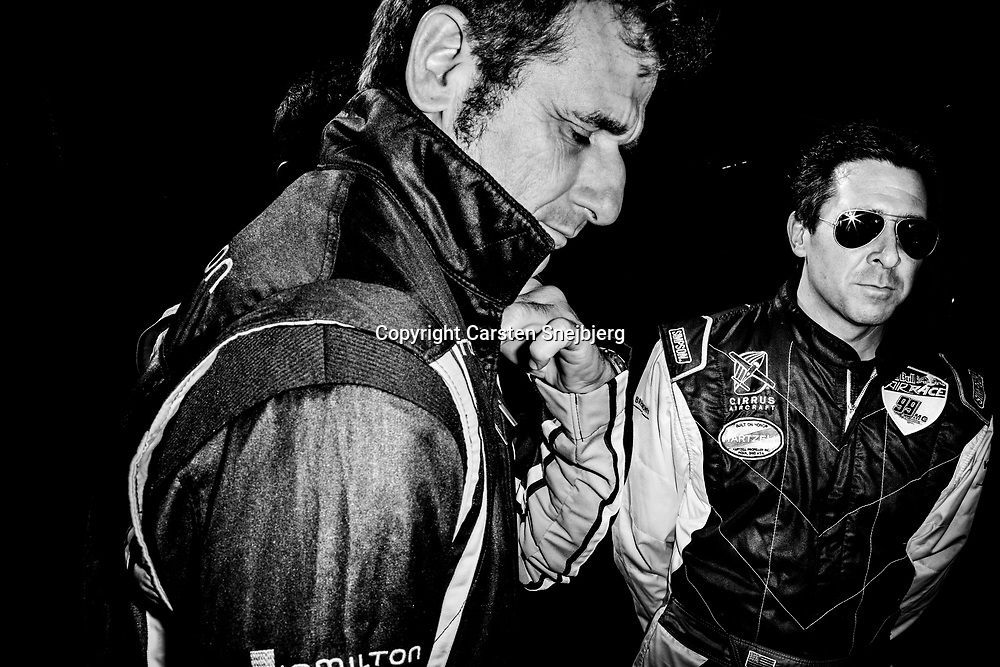 Nicolas Ivanoff and Michael Goulian meet in the hangar just before they are run around the track and presented to the audience.