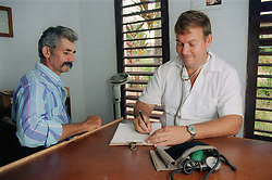 Resident doctor with a patient at a cooperative farm near Pinar del Rio; Cuba,