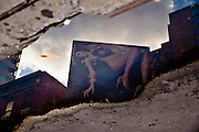 Reflection of a billboard on a puddle in SoHo, NYC