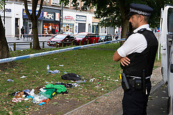 ©Licensed to London News Pictures 26/08/2020 New Addington,UK. Clothes and first aid bags on scene. Police at the scene. A 20 year old man is fighting for his life in hospital tonight after he was stabbed in New Addington, Croydon, South London. Local reports believe a machete was used in the attack. A police cordon is in place at the scene. Photo credit: Grant Falvey/LNP
