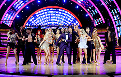 Host Ore Oduba (centre) dances with the celebrities and professional dancers taking part in the Strictly Tour during a photocall before the opening night of the Strictly Come Dancing Tour 2019 at the Arena Birmingham, in Birmingham. Picture date: Thursday January 17, 2019. Photo credit should read: Aaron Chown/PA Wire