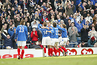 PORTSMOUTH 2 V SCUNTHORPE UNITED 1.     24.1.04. <br /> PORTSMOUTH'S GOALSCORER MATTHEW TAYLOR CELEBRATES HIS OPENING GOAL AS HE IS CONGRATULATED BY HIS TEAM MATES AGAINST SCUNTHORPE IN THE F.A. CUP FOURTH ROUND MATCH AT FRATTON PARK.<br /> PIC BY HARRY HERD/SPORTBEAT IMAGES