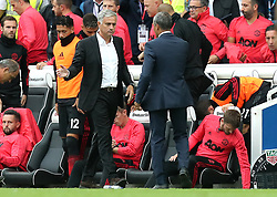 """Manchester United manager Jose Mourinho (left) and Brighton & Hove Albion manager Chris Hughton (right) shakes hands after the final whistle during the Premier League match at the AMEX Stadium, Brighton. PRESS ASSOCIATION Photo. Picture date: Sunday August 19, 2018. See PA story SOCCER Brighton. Photo credit should read: Gareth Fuller/PA Wire. RESTRICTIONS: EDITORIAL USE ONLY No use with unauthorised audio, video, data, fixture lists, club/league logos or """"live"""" services. Online in-match use limited to 120 images, no video emulation. No use in betting, games or single club/league/player publications."""