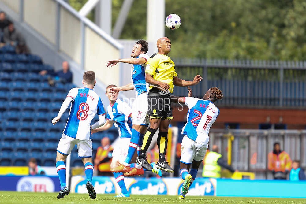 Gordon Greer of Blackburn Rovers and Lloyd Dyer of Burton Albion challenge each other in the air during the EFL Sky Bet Championship match between Blackburn Rovers and Burton Albion at Ewood Park, Blackburn, England on 20 August 2016. Photo by Simon Brady.
