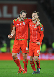 Gareth Bale of Wales celebrates with Aaron Ramsey of Wales after qualifying for Euro 2016 - Mandatory byline: Dougie Allward/JMP - 07966 386802 - 13/10/2015 - FOOTBALL - Cardiff City Stadium - Cardiff, Wales - Wales v Andorra - European Qualifier 2016 - Group B