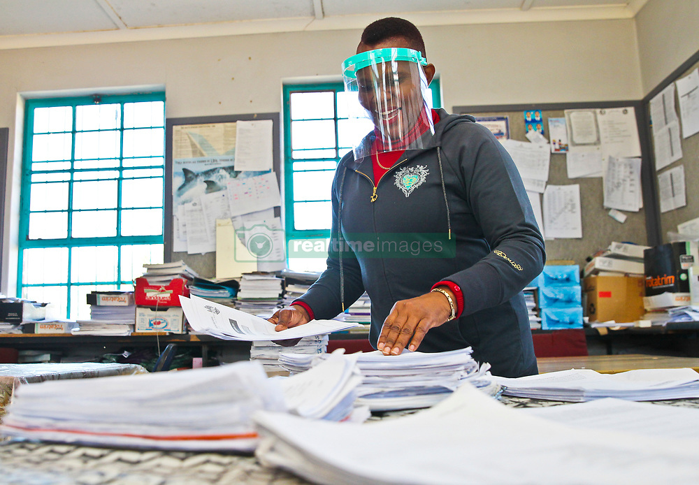 South Africa - Durban - 28 May 2020 - Educator Lungile Mzolo from Qhilika High school in uMlazi prepares some of her accounting papers as teachers returned to school on Thursday morning <br /> Picture: Doctor Ngcobo/African News Agency(ANA)