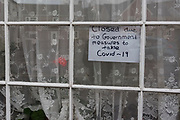 MERTHYR TYDFIL, WALES - 21 MARCH 2020 - Sign in the window explaining pub closed due to the Covid-19/coronavirus.