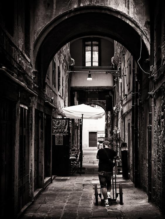 Italy - Venezia - Man on arcade street BW