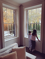 """Ivanka Trump releases a photo on Twitter with the following caption: """"""""The joy and wonder of watching the season's first snowfall!"""""""". Photo Credit: Twitter *** No USA Distribution *** For Editorial Use Only *** Not to be Published in Books or Photo Books ***  Please note: Fees charged by the agency are for the agency's services only, and do not, nor are they intended to, convey to the user any ownership of Copyright or License in the material. The agency does not claim any ownership including but not limited to Copyright or License in the attached material. By publishing this material you expressly agree to indemnify and to hold the agency and its directors, shareholders and employees harmless from any loss, claims, damages, demands, expenses (including legal fees), or any causes of action or allegation against the agency arising out of or connected in any way with publication of the material."""
