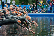 Competitors dive into the Sepentine at the start of the race. Elite Men - Pru Health World Triathlon, Hyde Park, London, UK on 31 May 2014. Photo: Simon ParkerElite Men - Pru Health World Triathlon, Hyde Park, London, UK on 31 May 2014. Photo: Simon Parker