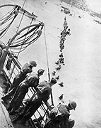 World War 2: British retreat from Dunkirk. British troops  wading out to board small boats which ferried them to larger vessels for transport back to UK. Constantly under German fire, between 26 May and 4 June, 300,000 members of the British Expeditionary Force and remnants of the French Army  were evacuated.