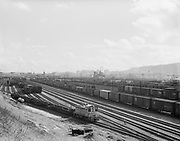 """Ackroyd 09631-1. """"Union Pacific RR Yards.  March 10, 1960"""" (Albina rail yards on East bank of Willamette. from bluff looking down.)"""