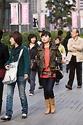 People walking on Nanjing Road, central Shanghai, China