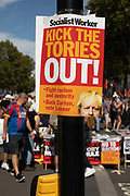 A Socialist Worker placard saying Kick The Tories Out on Whitehall for the Stop The Coup protest against the proroguing of Parliament on 31st August 2019 in London in the United Kingdom. Left-wing group Momentum and the Peoples Assembly coordinated a series of Stop The Coup protests across the UK today, aimed at Boris Johnson and the UK government proroguing Parliament.