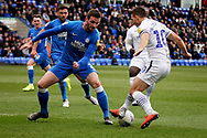 Peterborough Utd defender Jason Naismith (2) and Wycombe midfielder Matthew Bloomfield (10) during the EFL Sky Bet League 1 match between Peterborough United and Wycombe Wanderers at London Road, Peterborough, England on 2 March 2019.