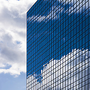 Reflections of the sky on the glass of an office building in downtown Edmonton.