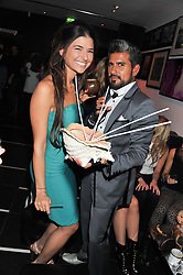 Lara Fraser and Azim Majid at a party to celebrate the opening of the Rum Shack, Floridita, 100 Wardour Street, London on 1st February 2013.