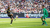 Football - 2019 / 2020 Premier League - West Ham United vs. Manchester City<br /> <br /> Raheem Sterling (Manchester City) lifts the ball over the on rushing Lukasz Fabianski (West Ham United) to score his second goal at the London Stadium<br /> <br /> COLORSPORT/DANIEL BEARHAM